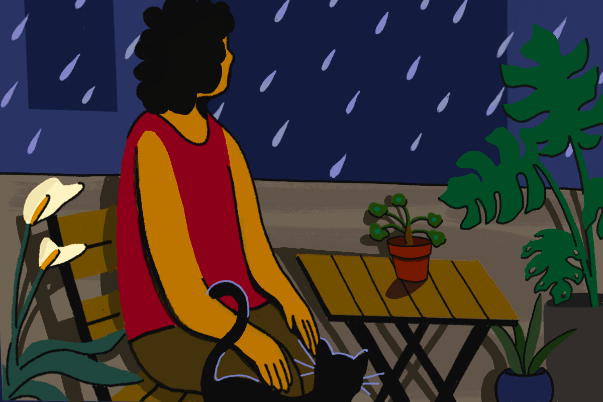 An illustration of person sitting on a chair, next to a wooden outdoor table and standing black cat. They are surrounded by pot plants and staring at the rain.